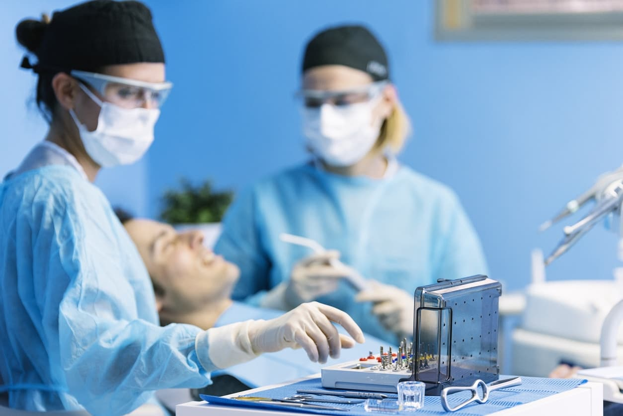 dentist with patient during procedure