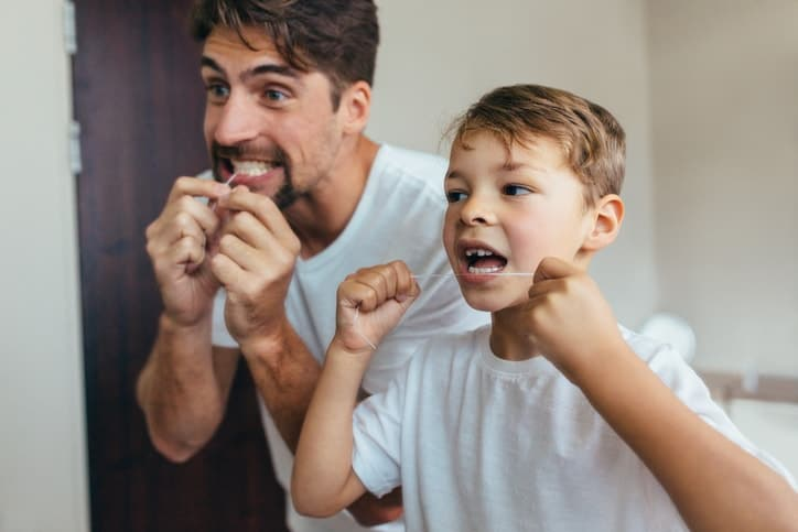 dad and son flossing
