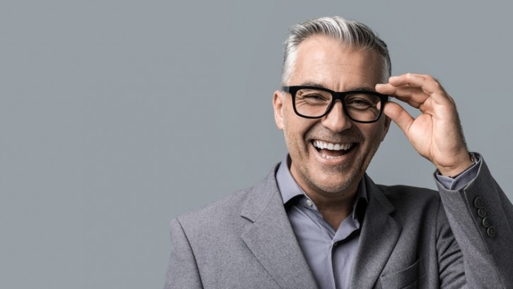 Smart businessman with glasses posing